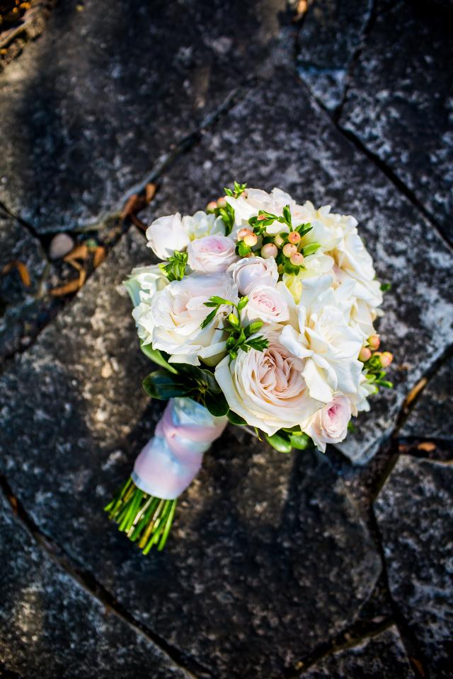 hand tied of garden roses, gardenias, berries
