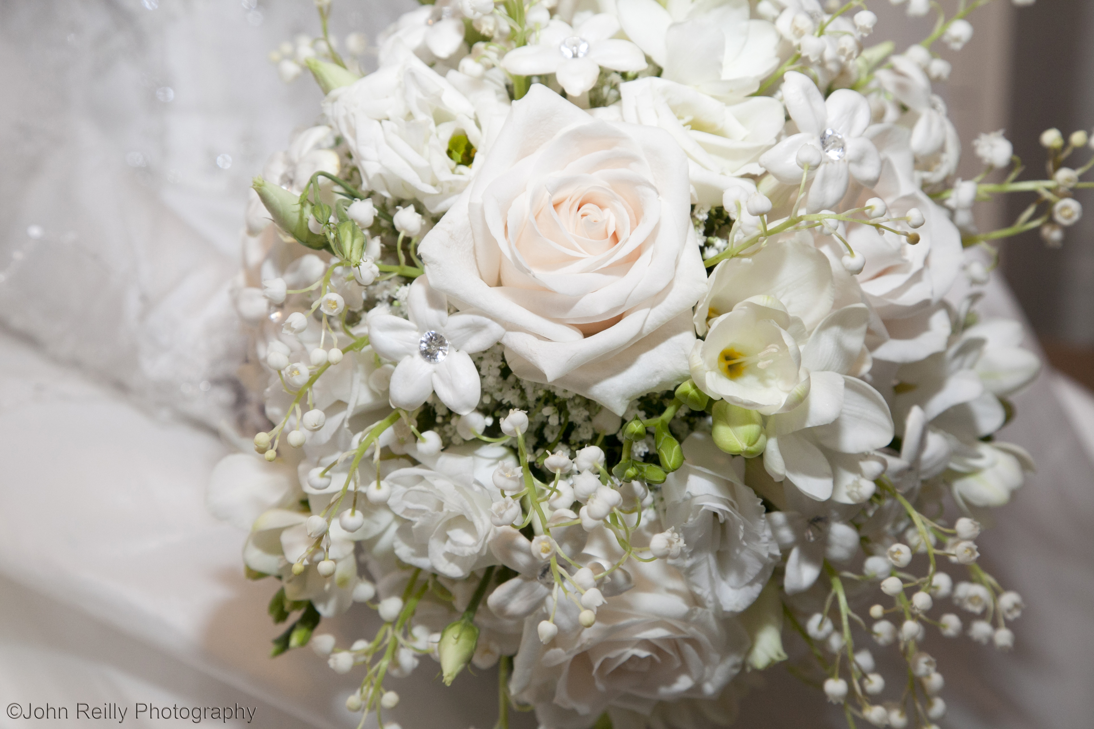 lily of the valley, roses, freesia, stephanotis ball