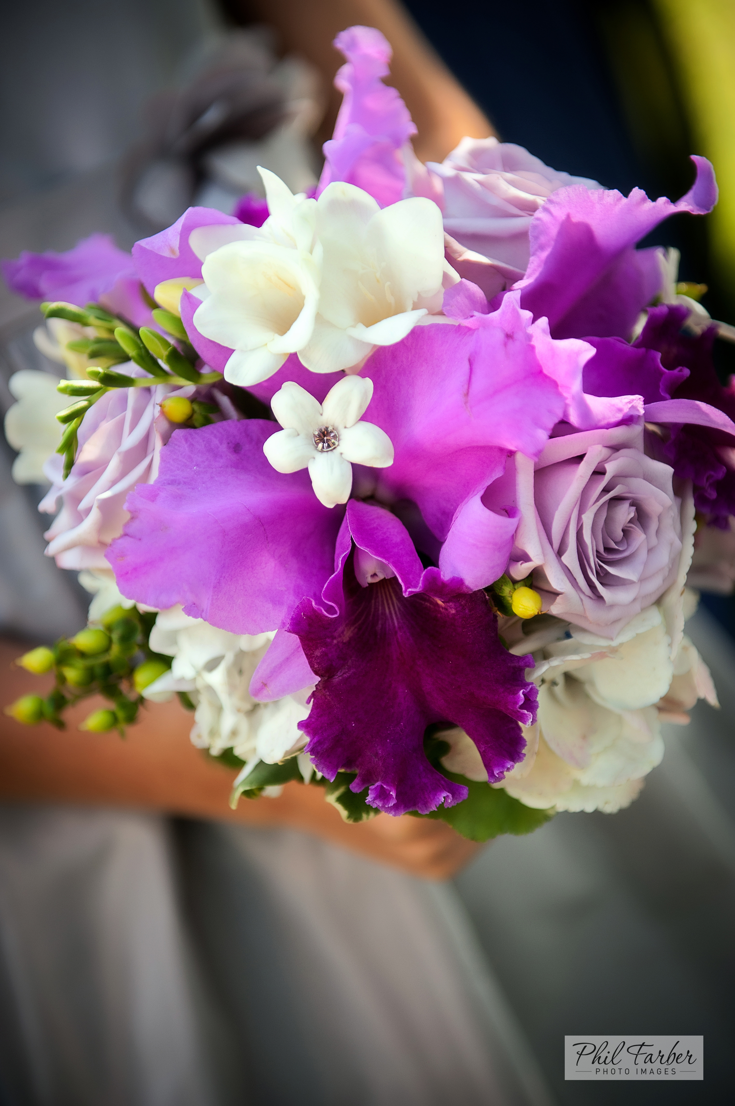 bridesmaid bouquet with fuschia catelaya orchids