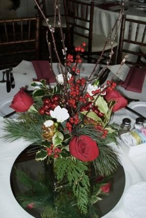 seasonal greens with berries, roses, ice branches