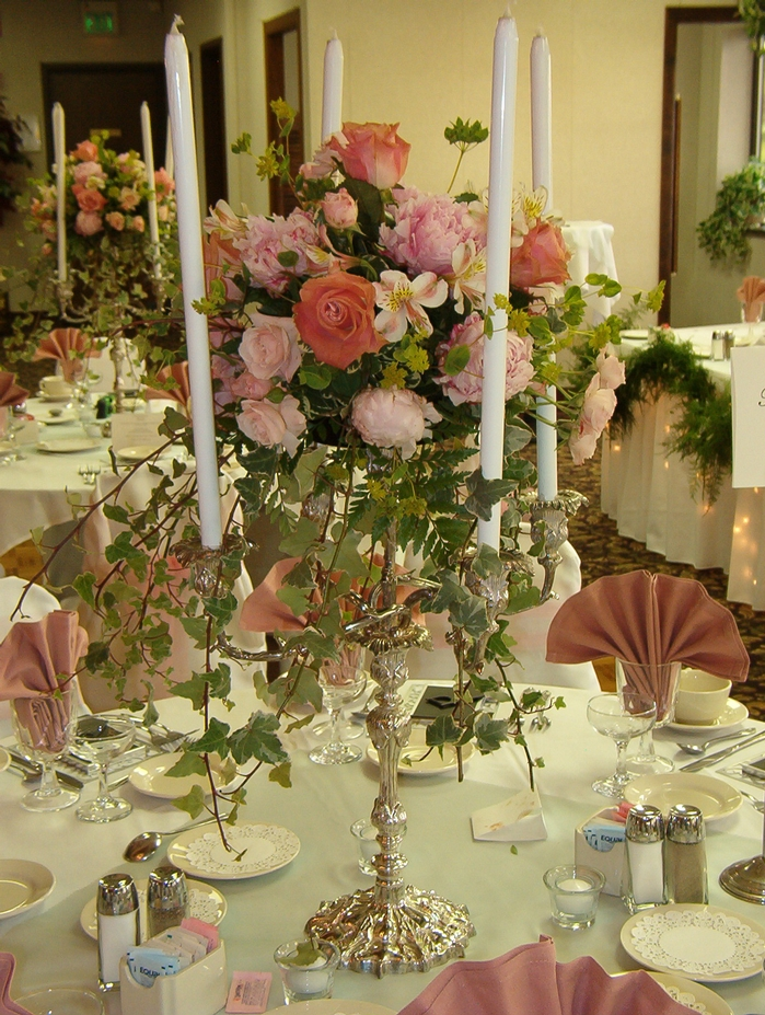 candelabra in pinks with taper candles